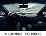 driving a car on winter road.... | Shutterstock . vector #560108680