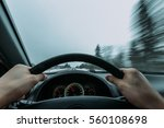 riding behind the wheel of a... | Shutterstock . vector #560108698
