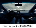 driving a car on winter road.... | Shutterstock . vector #560108746