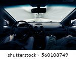driving a car on winter road.... | Shutterstock . vector #560108749