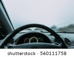 riding behind the wheel of a... | Shutterstock . vector #560111758