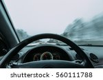 riding behind the wheel of a... | Shutterstock . vector #560111788