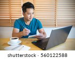 young man writing text message... | Shutterstock . vector #560122588