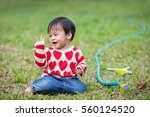 happy little baby boy playing... | Shutterstock . vector #560124520