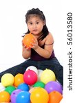 young asian kid playing with balloons - stock photo