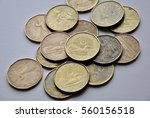 canadian loonies in the table | Shutterstock . vector #560156518