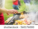 close up on hands grilling... | Shutterstock . vector #560176000