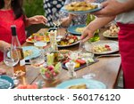focus on hands serving dishes...   Shutterstock . vector #560176120