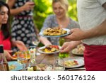 focus on hands serving dishes... | Shutterstock . vector #560176126