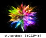 explosion of rainbow colored... | Shutterstock . vector #560229469