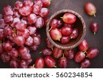 Red Grapes On Wooden Table  ...