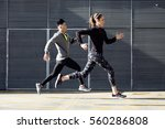 portrait of fit and sporty... | Shutterstock . vector #560286808