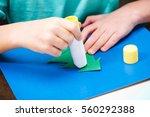 Cropped Shot Of Child Making...