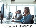 colleagues working in a call... | Shutterstock . vector #560305249