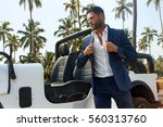 handsome man near the car in... | Shutterstock . vector #560313760
