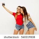 happy girls friends taking some ... | Shutterstock . vector #560319838