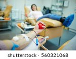 donor of blood gripping hand... | Shutterstock . vector #560321068