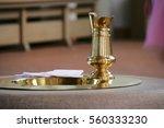 baptismal font and jug | Shutterstock . vector #560333230