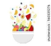 fruit bowl. slices of fruits.... | Shutterstock .eps vector #560335276