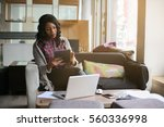 african american woman typing...   Shutterstock . vector #560336998