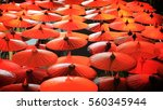 umbrella standing out from the... | Shutterstock . vector #560345944