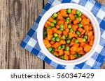 peas and carrots in a white... | Shutterstock . vector #560347429