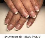 beautiful woman's nails | Shutterstock . vector #560349379