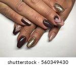 beautiful woman's nails | Shutterstock . vector #560349430