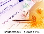 loan agreement on a clipboard... | Shutterstock . vector #560355448