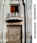 Small photo of Metal doors of the side entrance and a balcony of the old Sikh gurudvary Bangla Sahib in Delhi, India