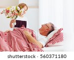 young grandson with flower... | Shutterstock . vector #560371180