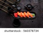 japanese cuisine. salmon sushi  ... | Shutterstock . vector #560378734