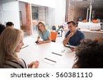 multiethnic startup business... | Shutterstock . vector #560381110