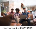 multiethnic startup business... | Shutterstock . vector #560391700