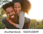 man carrying young woman on his ...   Shutterstock . vector #560410849