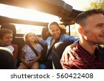 happy family on a road trip in... | Shutterstock . vector #560422408