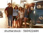 Small photo of Friends in a camper van make a roadside stop, full length