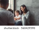 mother  father and two sons on... | Shutterstock . vector #560429590