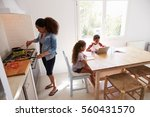 mum cooking while kids work at... | Shutterstock . vector #560431570