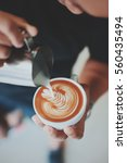 coffee latte art in coffee shop ... | Shutterstock . vector #560435494