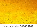 Stock photo drops of water on a glass of beer background texture 560435749