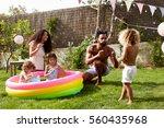 family having fun in garden... | Shutterstock . vector #560435968