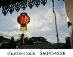 Small photo of Red Chinese lamp under blue sky in the evening. The words in the middle means Great good luck, the right one basically mean may you be prosperous.