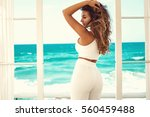 sexy young woman in white... | Shutterstock . vector #560459488