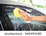 old man washing car at home.... | Shutterstock . vector #560494180