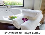 white towels on bathtub in... | Shutterstock . vector #560516869