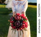 Bride Holding Bouquet With Red...