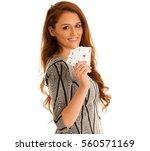 beautiful brunette holding four ... | Shutterstock . vector #560571169