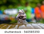 A Statue Of Sitting Frog On To...