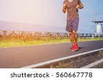 handsome man running on road...   Shutterstock . vector #560667778